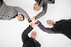 Businessteam holding hands in unity stock photo