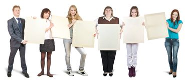 Businessteam holds blank canvases Stock Photos