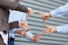 Businessteam Joining Fingers Against Shutter Royalty Free Stock Photo