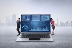 Businessteam lean on laptop Royalty Free Stock Image