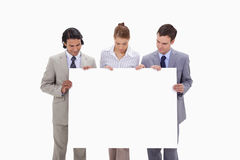 Businessteam looking at blank sign in their hands Royalty Free Stock Photos
