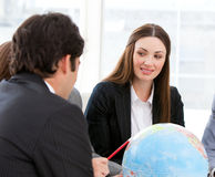 Businessteam looking at a terrestrial globe Royalty Free Stock Photography