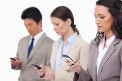 Businessteam looking at their cellphones Royalty Free Stock Images