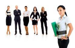 Businessteam mit einer Geschäftsfrau, die es führt lizenzfreies stockfoto