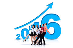 Businessteam with numbers 2016 and upward arrow Royalty Free Stock Photo
