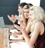 Businessteam at a presentation clapping Stock Images