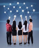 Businessteam que empurra a rede social Fotografia de Stock