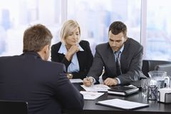 Businessteam reviewing documents. Together at meeting in office royalty free stock photography