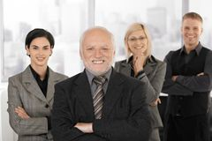 Businessteam smiling in office Royalty Free Stock Photo