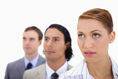 Businessteam standing in a row looking right Stock Photography