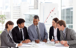 Businessteam talking taking note during a meeting stock photos