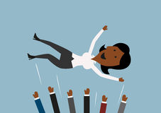 Businessteam throwing businesswoman into the air Royalty Free Stock Image