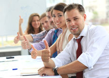 Businessteam with thumbs up. After a presentation in office Royalty Free Stock Photo