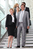 Businessteam walking down steps Royalty Free Stock Images