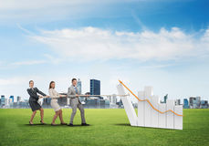 Businessteam working in collaboration making diagram grow and progress Royalty Free Stock Image