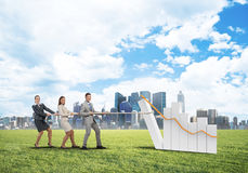 Businessteam working in collaboration making diagram grow and progress Stock Image