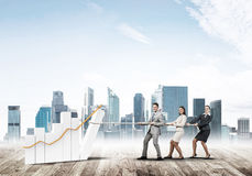 Businessteam working in collaboration making diagram grow and progress Stock Photography