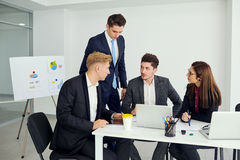 Businessteam working at  desk  a modern office. Training busines Stock Image