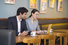 Businessteam working on laptop at coffee bar Stock Photography