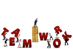 Businessteam working to build teamwork text Royalty Free Stock Images