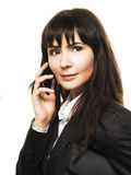 Businesswoman. Young woman with briefcase speaking by phone Royalty Free Stock Photo