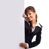 Businesswoman. Beautiful smiling girl holding a blank billboard stock photo