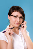 Businesswoman. Working, holding a cellphone royalty free stock photo