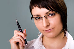 Businesswoman. Holding a pen and thinking royalty free stock photography