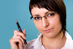Businesswoman. Holding a pen and thinking stock photography
