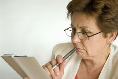 Businesswoman. Reading in the office Stock Images