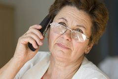 Businesswoman. In the office on a phone Stock Photography