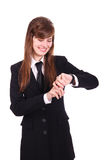 Businesswoman. Happy businesswoman looks at the wrist watch Stock Photos