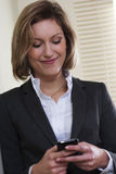 Businesswoman. Text messaging on mobile phone Royalty Free Stock Photo