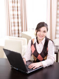 Businesswoman. Young adult businesswoman at home royalty free stock images