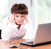 Businesswoman. Beautiful  businesswoman working with laptop at her office Royalty Free Stock Photos