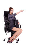 Businesswoman. A young woman with a folder in his hands sitting on a comfortable chair Stock Image