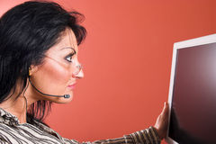 Businesswoman. Surprised woman with headset looking at the computer monitor Royalty Free Stock Photos