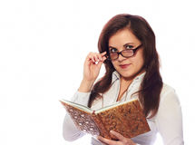 Businesswoman. Smiling girl in glasses with a book on a white background Royalty Free Stock Images