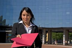 Businesswoman. Downtown holding a file Stock Photos