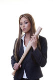 Businesswoman. Woman holding a baseball bat as if she is about to hit someone or some thing Royalty Free Stock Image
