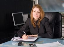 Businesswoman. In her working encironment stock photos
