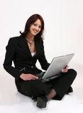 Businesswoman. Sitting on ground working on her computer Stock Photos
