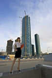 Businesswoman. On a background of a under construction skyscraper Stock Photo