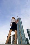 Businesswoman. On a background of a under construction skyscraper Stock Photography