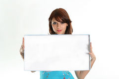 Businesswoman. The girl in a  blue dress holds blank for advertising Stock Photo