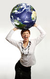 Businesswoman. Young attractive businesswoman holding the Earth in her hands royalty free stock images