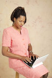Businesswoman on 3G Network. Businesswoman uses a tiny netbook computer to access the internet Royalty Free Stock Photos