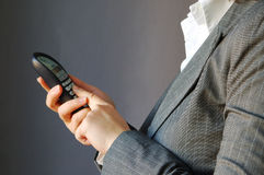 Businesswoman. The young businesswoman using phone Royalty Free Stock Image
