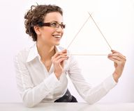 Businesswoman. Young businesswoman showing a triangle symbol royalty free stock photography