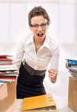 Businesswoman!. Businesswoman screaming, beautiful secretary at work royalty free stock images